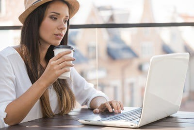 Lady-drinking-Coffee-on-Computer_0.jpg