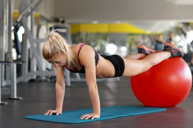 woman-doing-push-ups-on-a-red-ball_1208-291.jpg